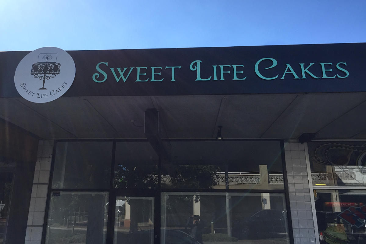 Cake store building sign