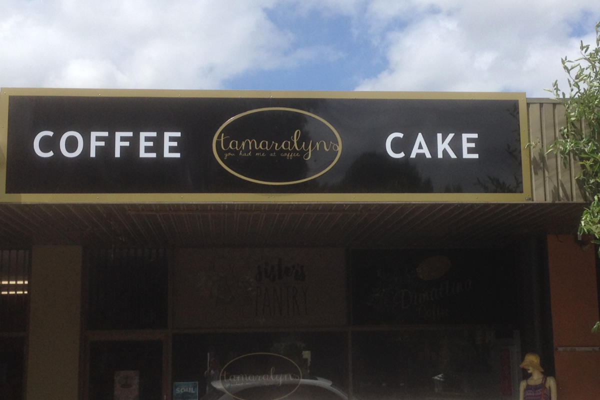 Coffee and Cake cafe building sign