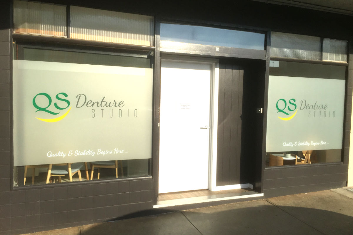 Frosted window signage for denture studio