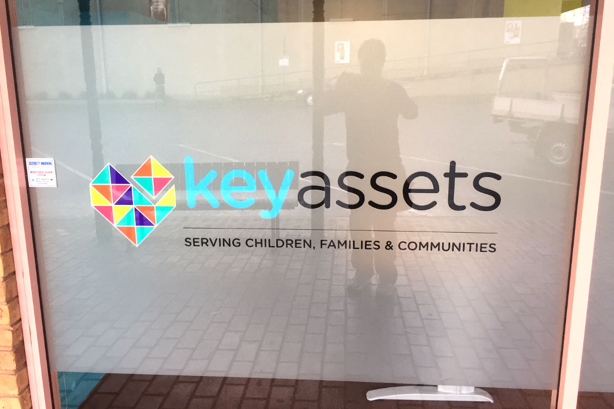 Frosted window signage for Key Assets children's services
