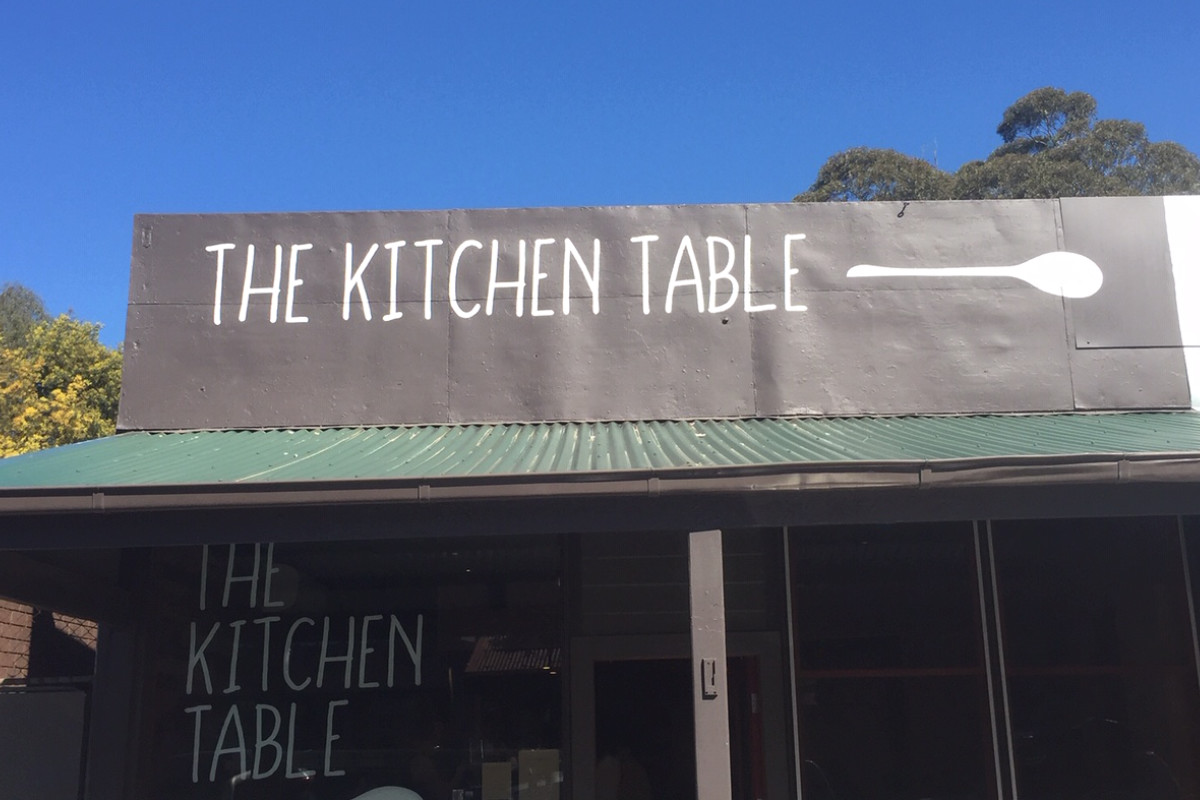 Hand painted building sign for The Kitchen Table by Signspec Signs
