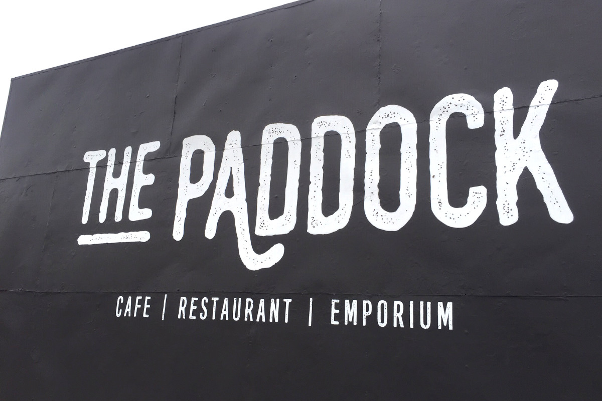 Hand-painted building sign for The Paddock cafe, restaurant and emporium sign by Signspec
